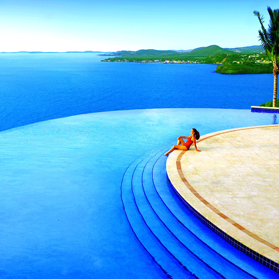 Save on a vacation package to puerto rico pictured here for Isla leon piscina