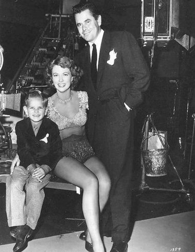 Eleanor Powell is visited by Glenn Ford and son, Peter.