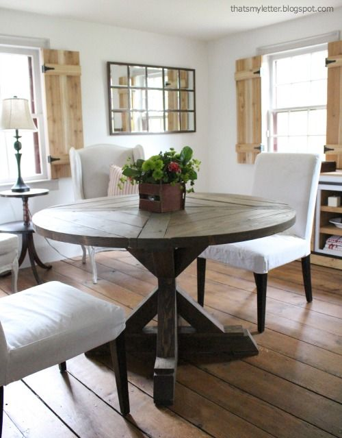 LOVE this circular dining table built with an X base using plans from Ana White - http://ana-white.com/2013/07/plans/square-x-base-pedestal-dining-table