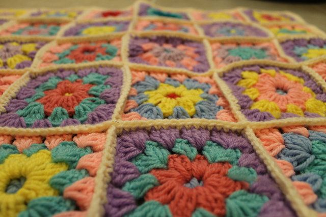 'Girl's Pink and Multi-Colored Hand Crocheted Baby Granny Square Afghan' is going up for auction at  9pm Fri, Sep 7 with a starting bid of $19.