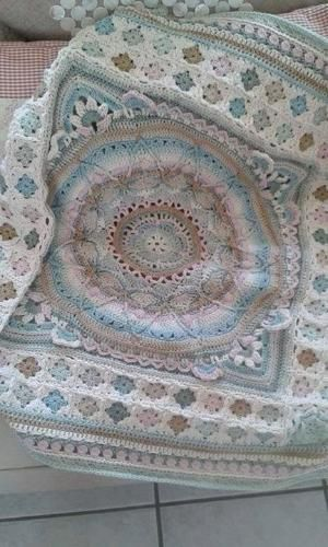 Sophie's garden turned into afghan with small granny squares and a tulip border, beautiful by Michelle van Aardt by Anubis Excipion