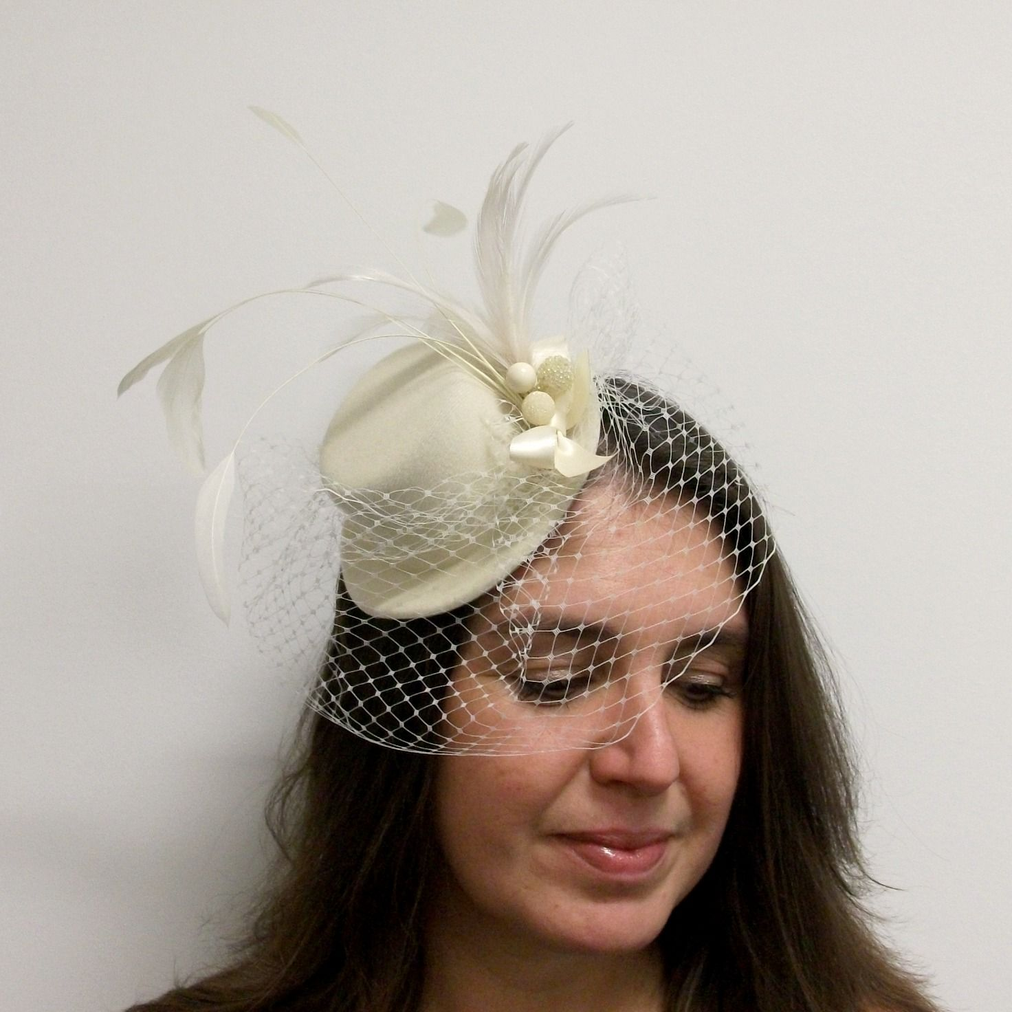 Ivory Mini Top Hat Fascinator With Bird Cage Veil