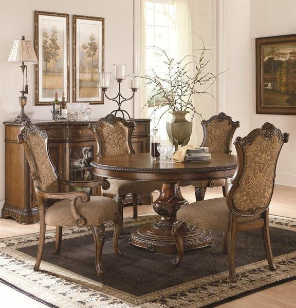 The+Pemberleigh+Round+Table+Dining+Room+Collection+with+Upholstered+Chairs
