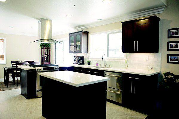 espresso cabinets with white quartz countertop and white glass subway tile - White Countertops