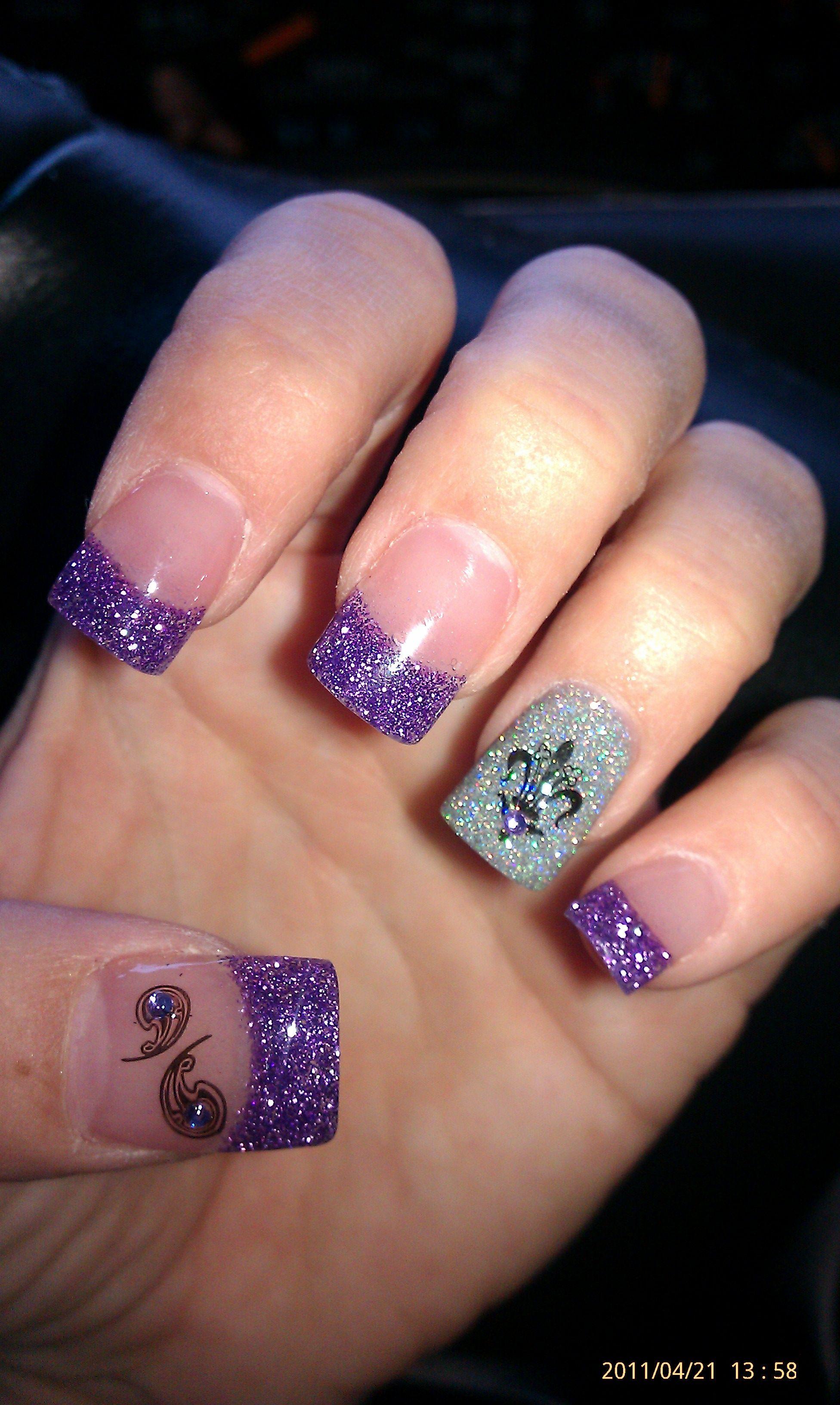 purple glitter, fluer de lis konad stamp art with rhinestone under silver glitter on ring finger, paisley konad stamp w/ jewel on thumb...