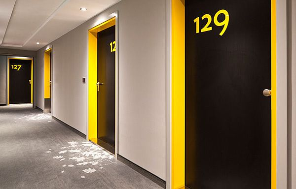 This Is An Interesting And A Modern Way To Display Door Numbers I Noticed That Yellow Is One Of The More Popular Corridor Design Hostels Design Hotels Design