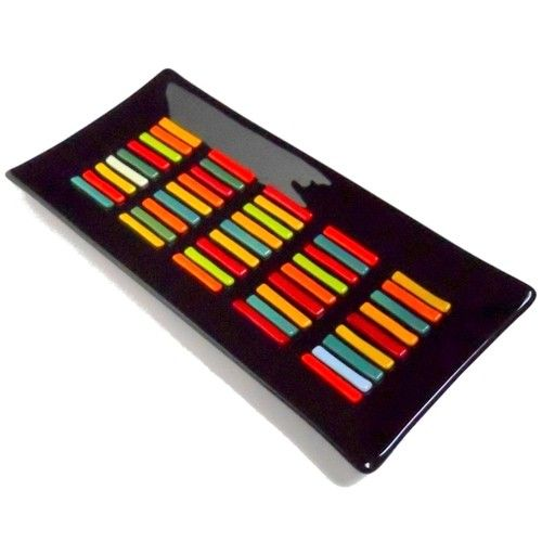 ResetarGlassArt: This large fused glass tray has a black base accented with forty five bars of brilliant color.  Bars of reds, oranges, yellows and greens form raised rows in the center of the plate.          This rectangle plate measures approximately 7 x 14 1/4 inches (17.5 x 36.5 cm)and the bottom includes my signature and the year made in 24k gold permanent ink.
