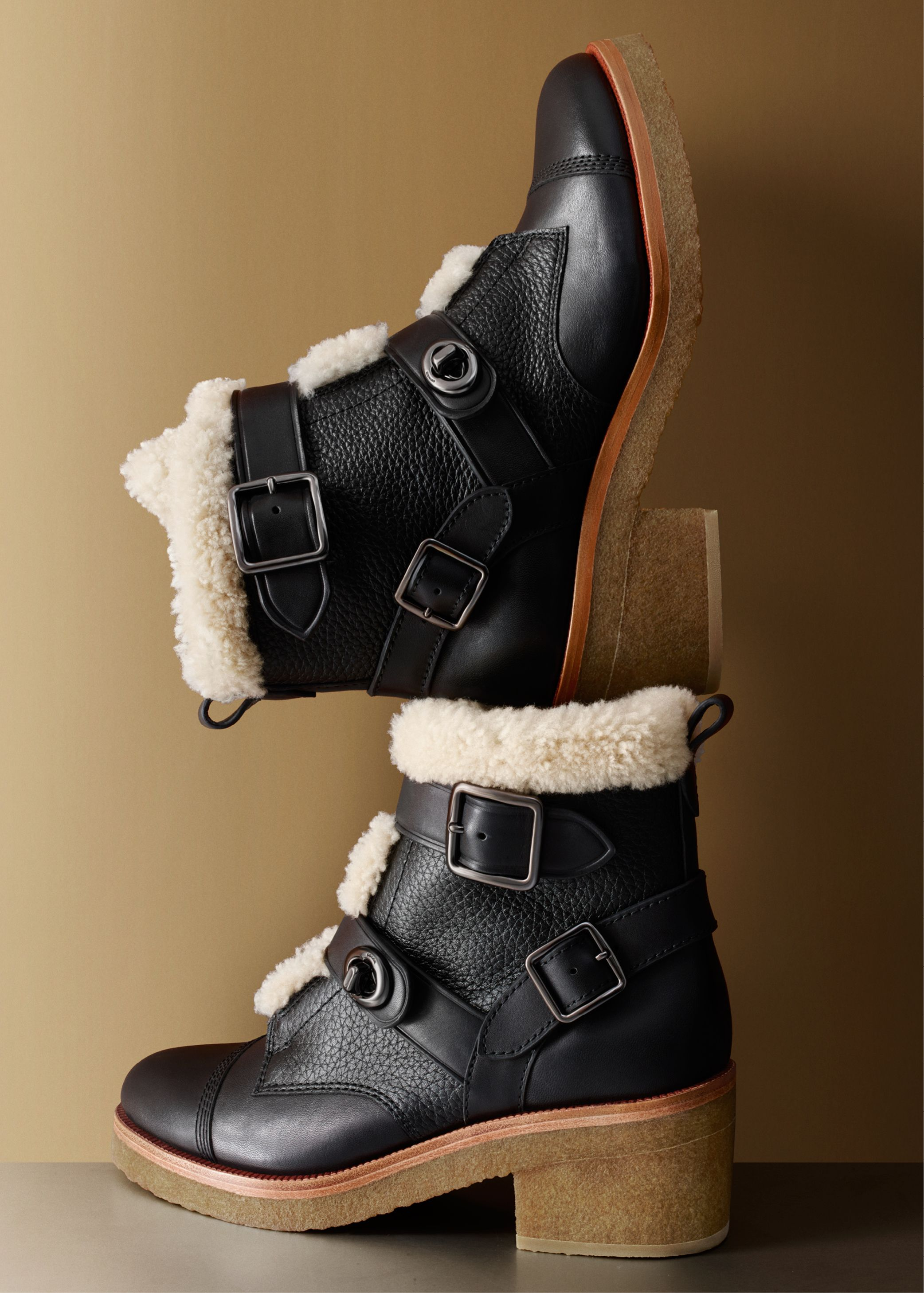 Pebble and smooth leathers topped with plush, curly shearling create a luxurious play of textures on this new boot, a cozy pick for the cooler temperatures to come.
