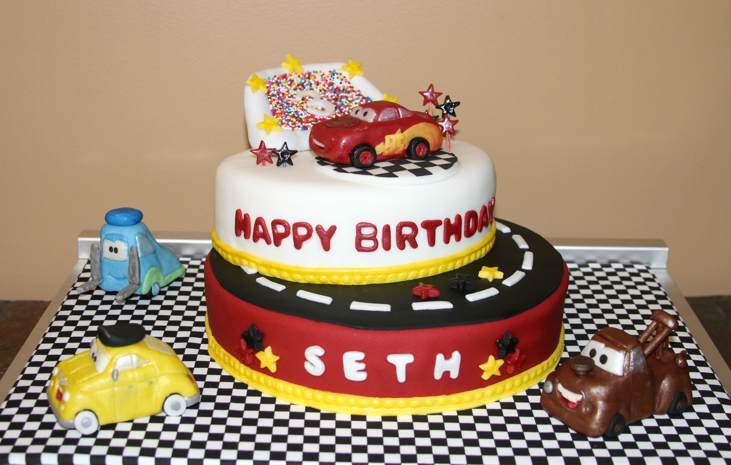 Cars Birthday Cake - All Edible, Hand Crafted Cars and Decorations      www.BeyondUsualCakes.com