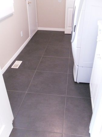 Beige Floor Vent Cover on Charchoal Floor Tile