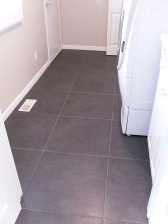 Beige Floor Vent Cover on Charchoal Floor Tile