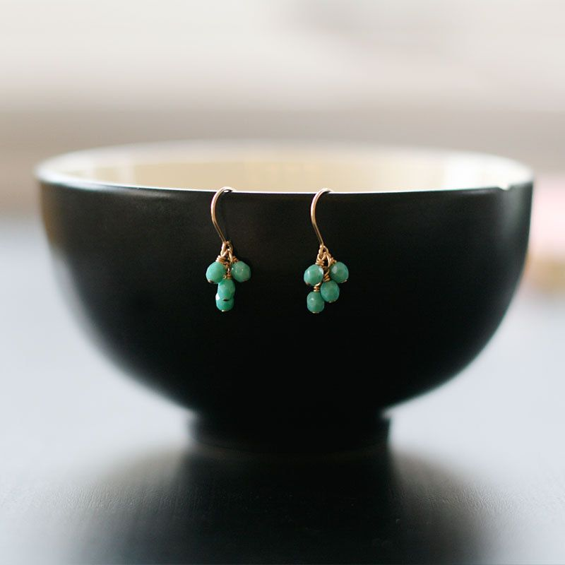 Delicate drops of turquoise glass on gold-filled wire.
