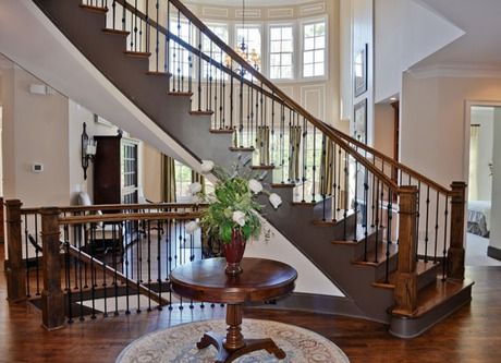 A Dramatic Spiral Staircase Serves As A Defining Centerpiece In The Foyer  Of This Stunning Home