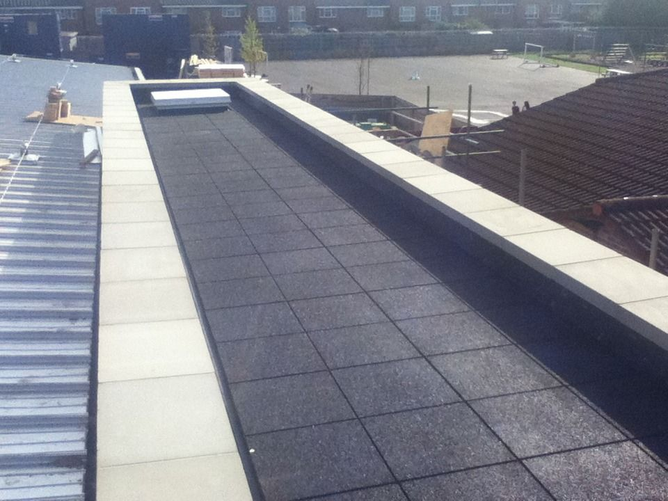 EPDM single ply membrane with rubber walkway tiles by