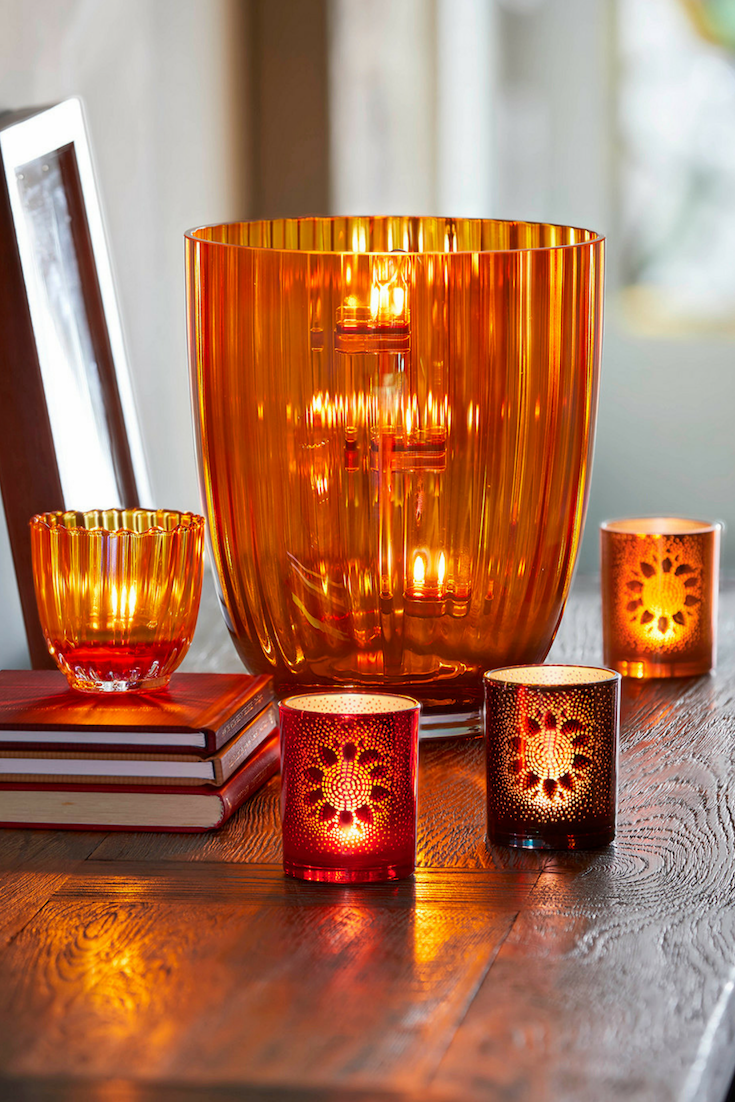 Transform Your Living Space With The Shades And Scents Of Fall Seen Here Amber Lights H Glass Hurricane Candle Holder Candle Holders Hurricane Candle Holders