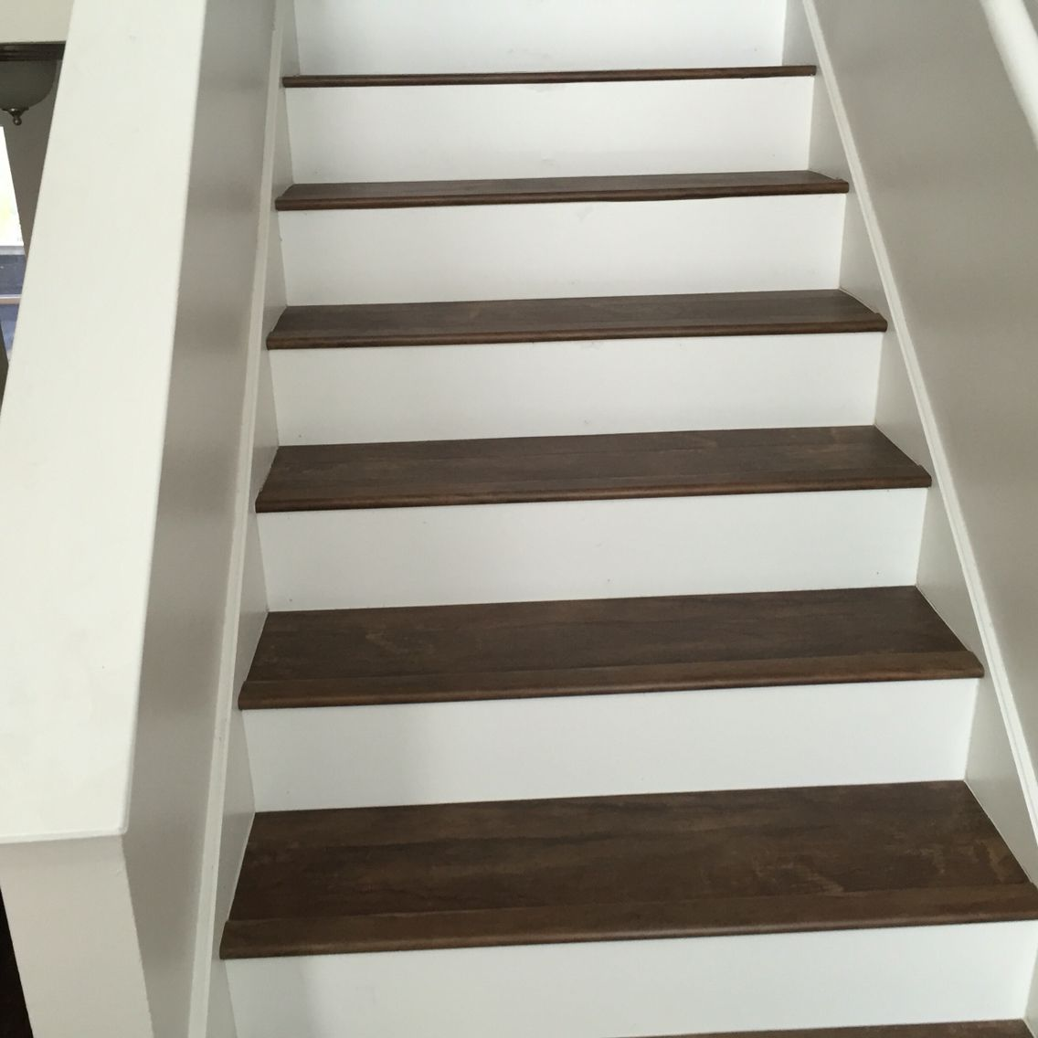 Luxury Vinyl Plank On Stairs With White Risers Luxury Vinyl | Wood Look Vinyl Stair Treads | Ceramic Tile | Shaw Floorte | Laminate Flooring | Roppe | Stair Makeover