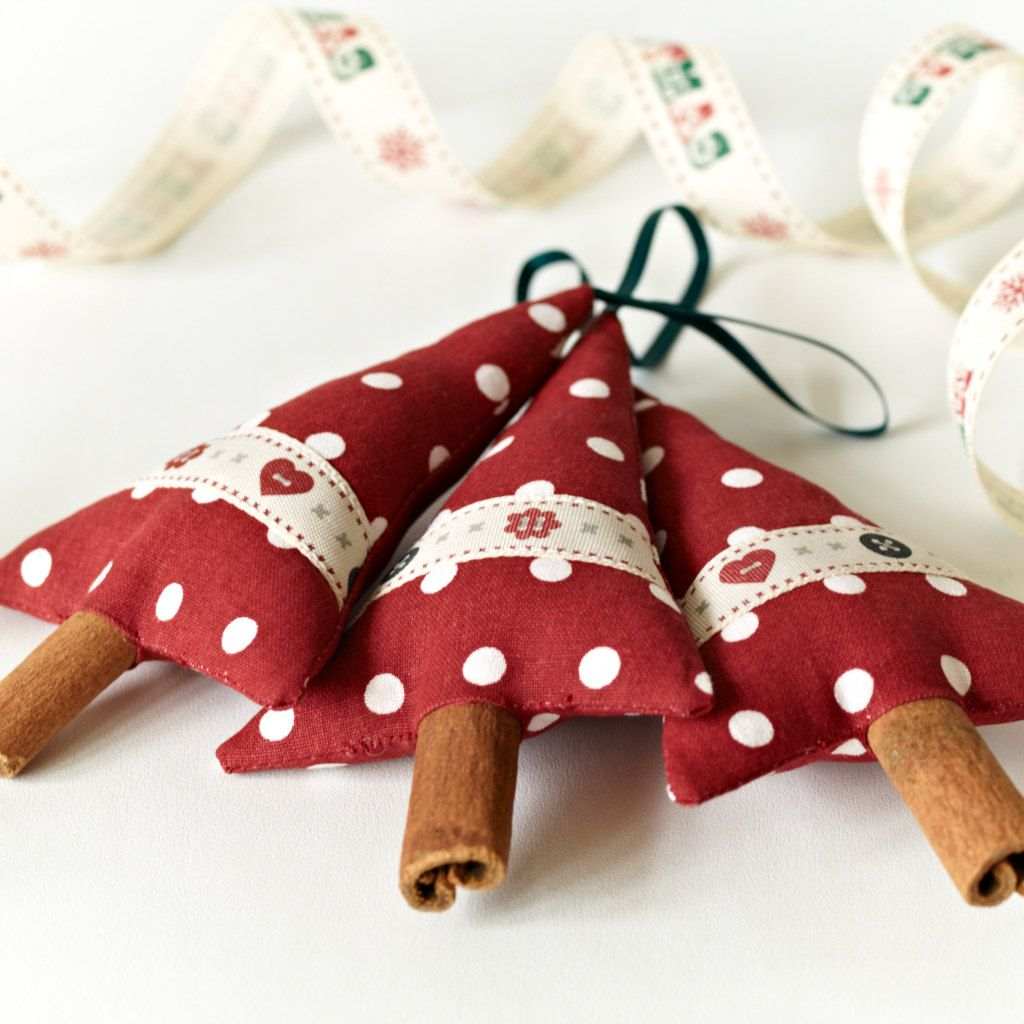 Cinnamon Stick and Fabric Christmas Tree Ornaments..looks easy to copy and use in place of a ribbon on a package
