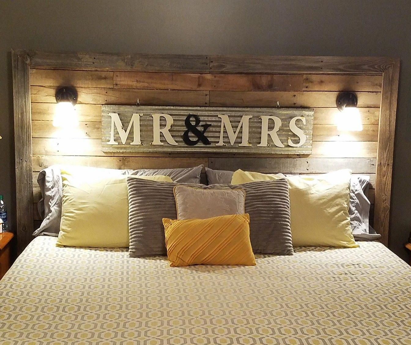 My hubby made us a king size pallet bed, added our Mr