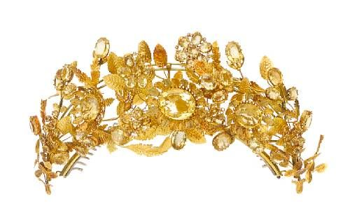 A gold and citrine tiara, with masses of gold foliage, oval and round citrines as flower heads and buds.