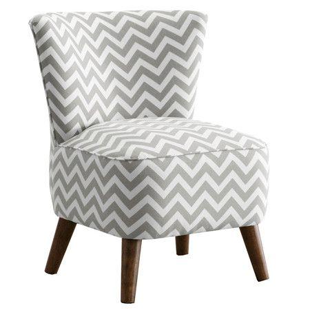 Las patas de esta silla y su forma irregular la hacen lucir estilizada, la tela muy original, felicitaciones...