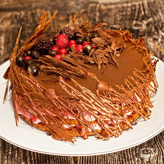 This is a delicious healthy Vegan Chocolate Cake with natural sugar, filled with berries, and covered in a lot of chocolate.