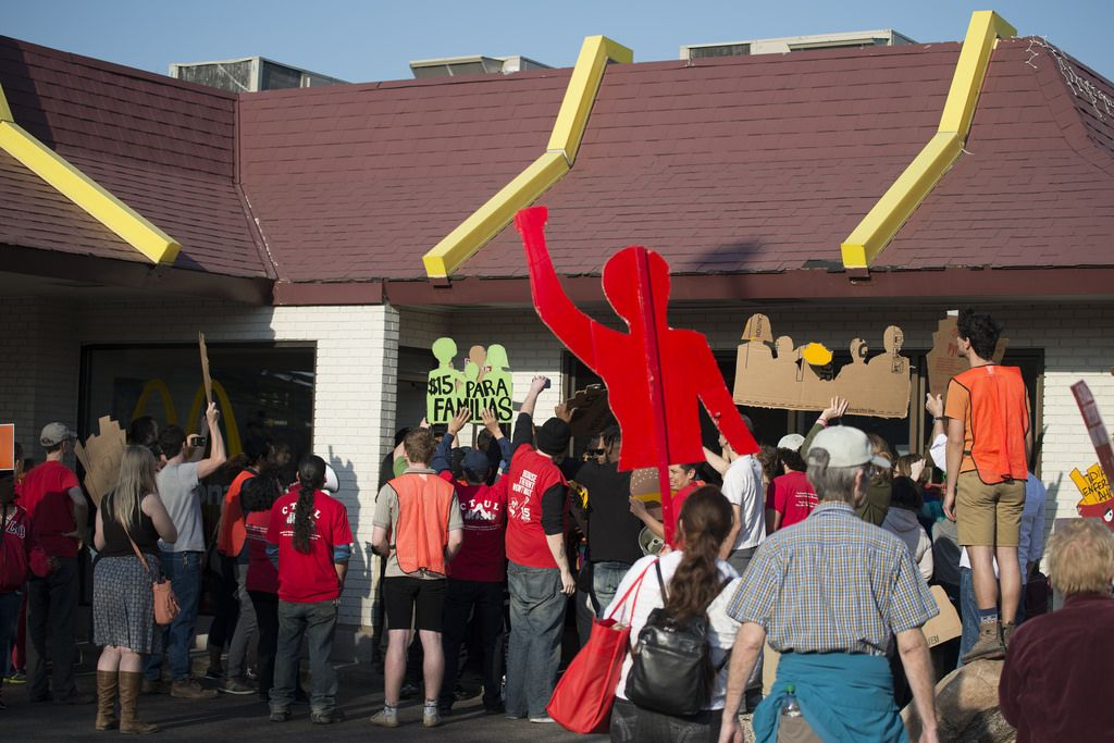 Fast food workers on strike attempt to get inside McDonald's