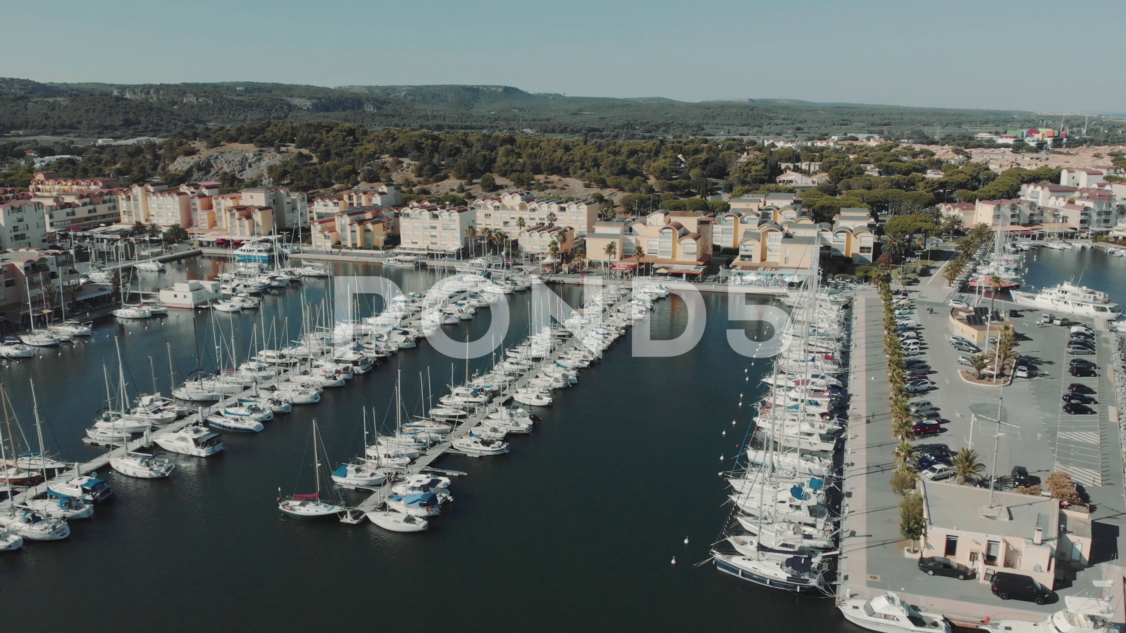 Aerial drone flying out over a marina for boats and tourist ships. Many yachts Stock Footage ,#mari