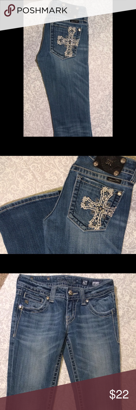 """Miss Me bootcut Size 26. Cross Bling Miss Me bootcut Size 26. 32"""" inseam Cross Bling.  Minimal wear.  Overall great condition Miss Me Jeans Boot Cut"""