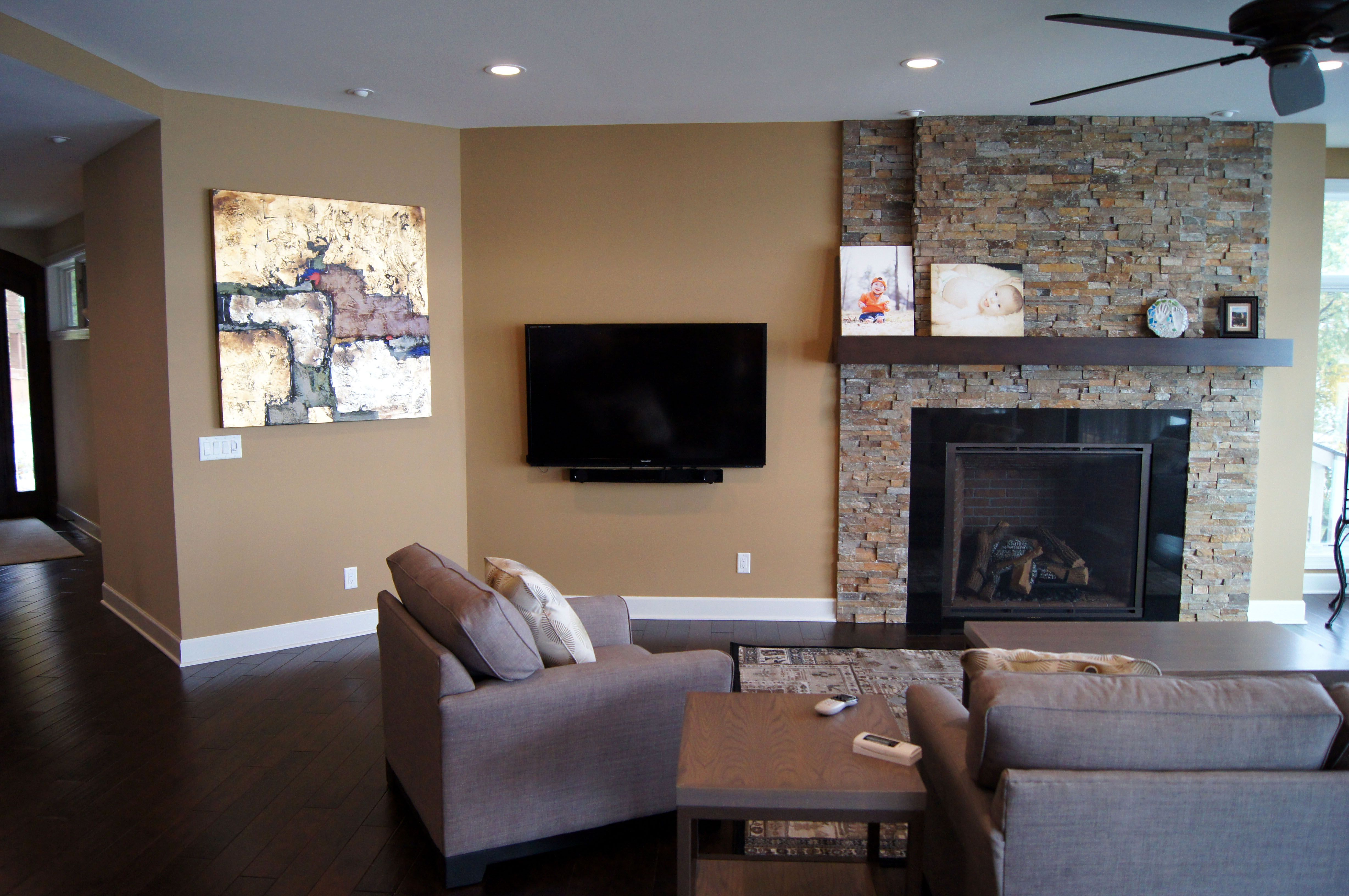 Soft earth tones in living room compliment the stone fireplace. Home designed by Udvari-Solner Design Company which specializes in residential design and is located in Madison, WI.