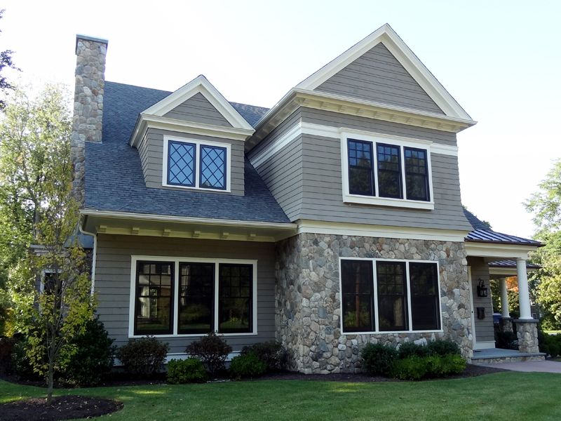 Home With Round Natural Stone Siding Columns And Chimney Stone Siding Exterior Stone Veneer Exterior Exterior Stone