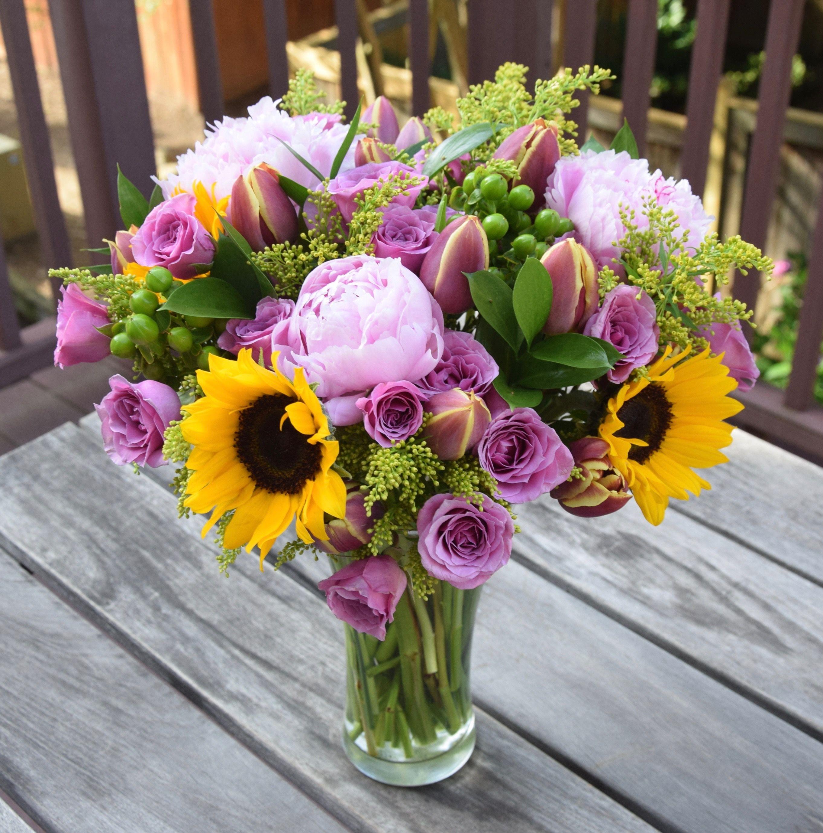 Table Flower Arrangement Consist Of Sunflower Roses Eustomas To Brighten The Work Day Shop Flower Delivery Same Day Flower Delivery Table Flower Arrangements