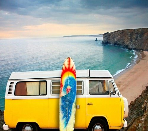 yellow vw bus by the beach and a surfboard das vintage. Black Bedroom Furniture Sets. Home Design Ideas