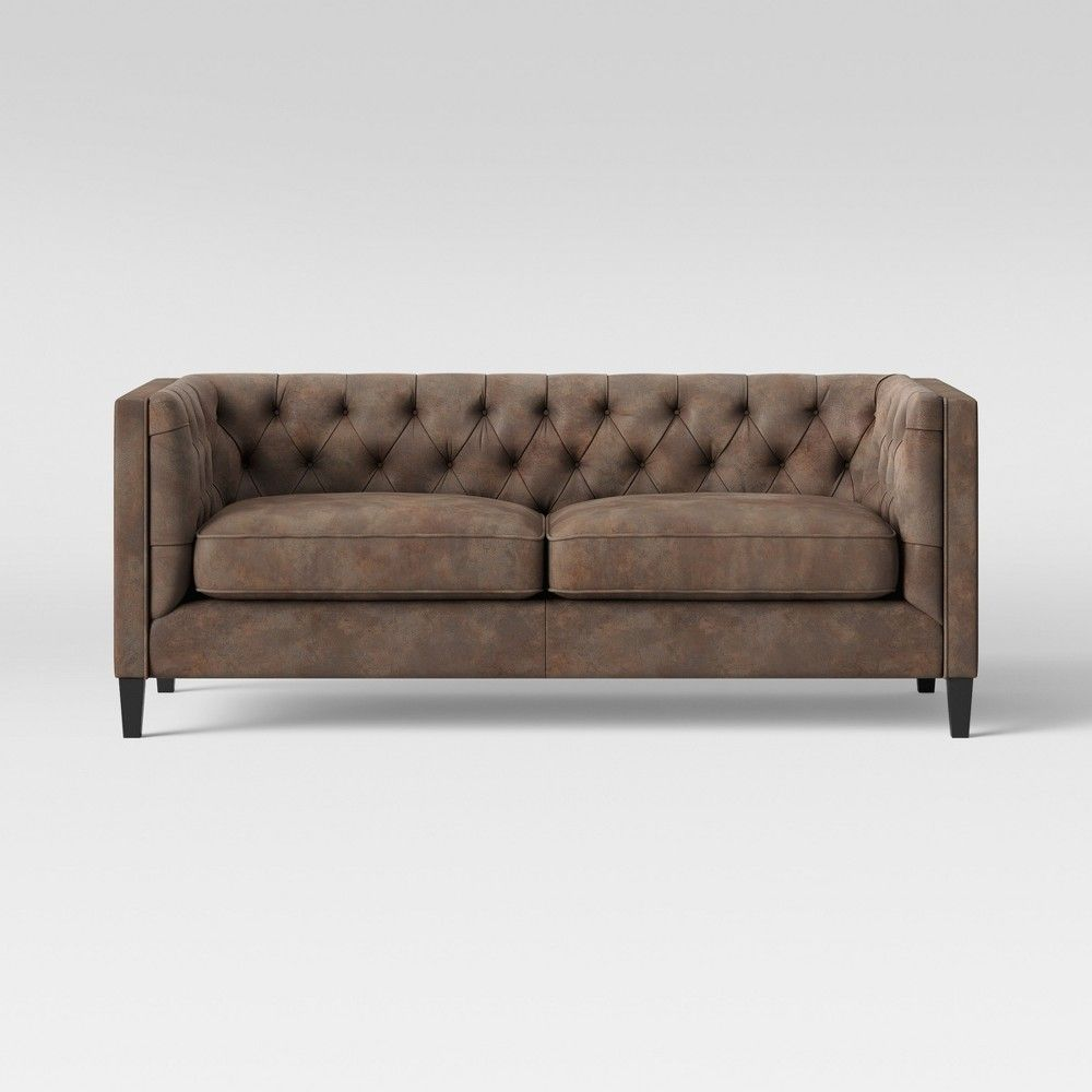 Give your sitting room a proper place to perch with the Lewes Tufted Faux Leather Sofa from Threshold The cozy nook for two is perfect for giving a comfortable spot to si...