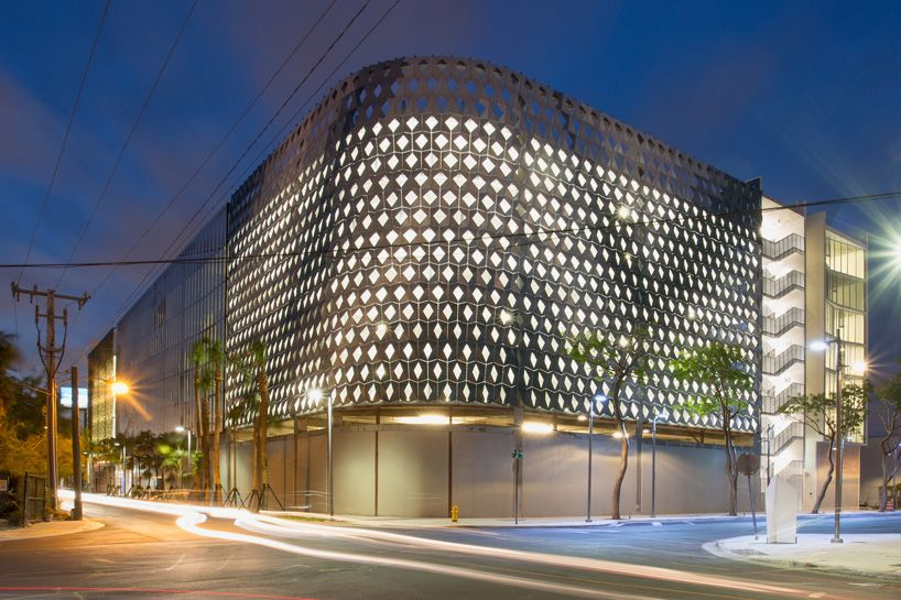 iwamotoscott clads city view garage with a perforated aluminum façade