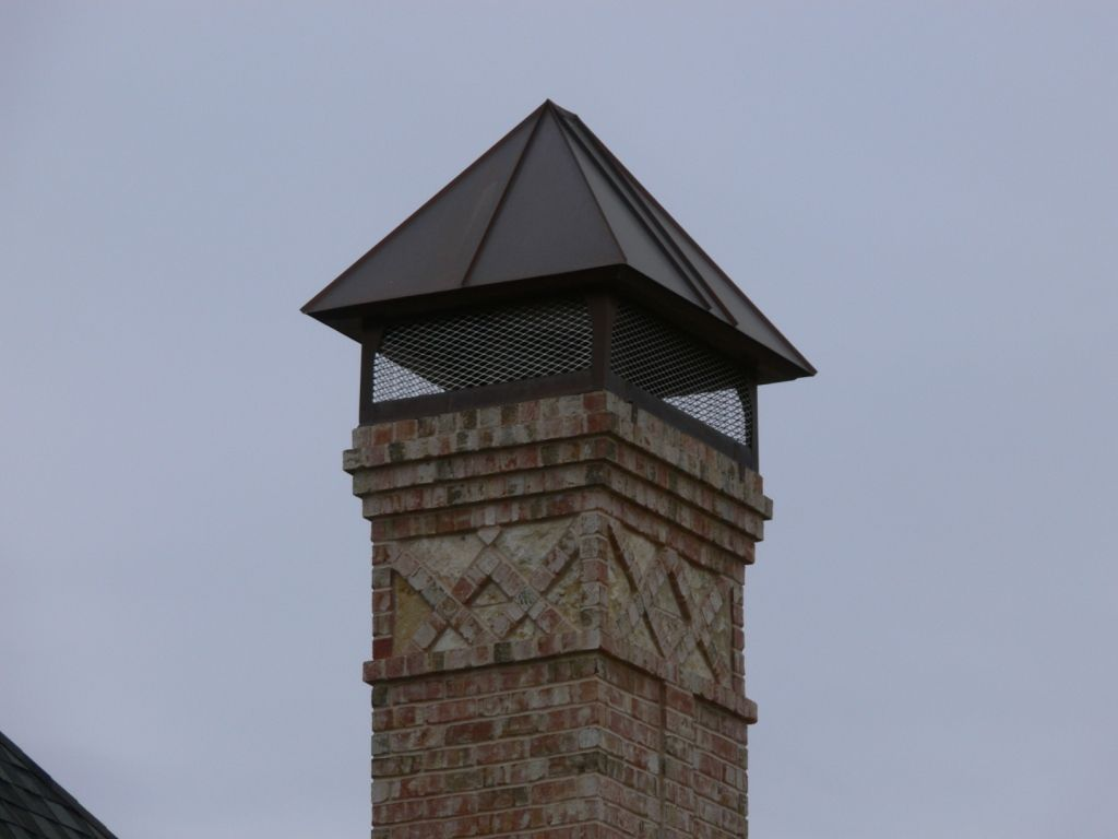 Copper Chimney Cap The Pyramid Shape Of This Chimney Cap Thin Standing Seams And Exposed Mesh Is A Modern Variation On T Gutters Chimney Design Chimney Cap