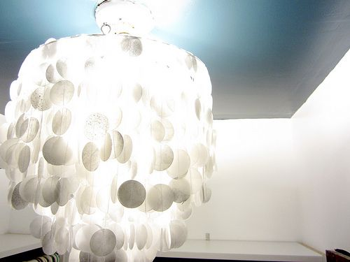 Wax Paper Capiz Shell Chandelier A Lot Cheaper Than The Real Thing Capiz Shell Chandelier Diy Chandelier Chandelier Decor