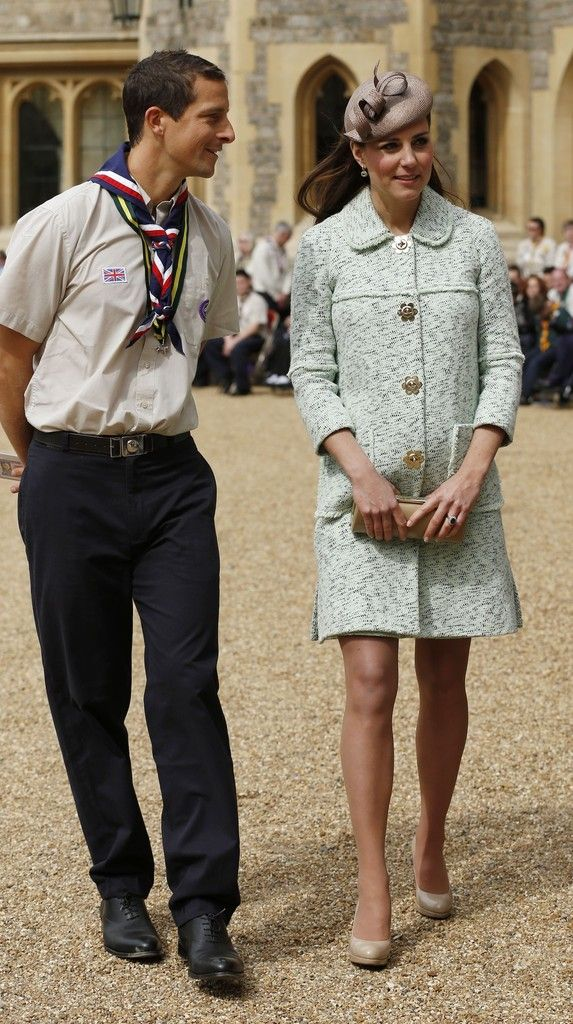 Catherine, Duchess of Cambridge walks with Chief Scout Bear Grylls (L) as she attends the National Review of Queen's Scouts at Windsor Castle on April 21, 2013.
