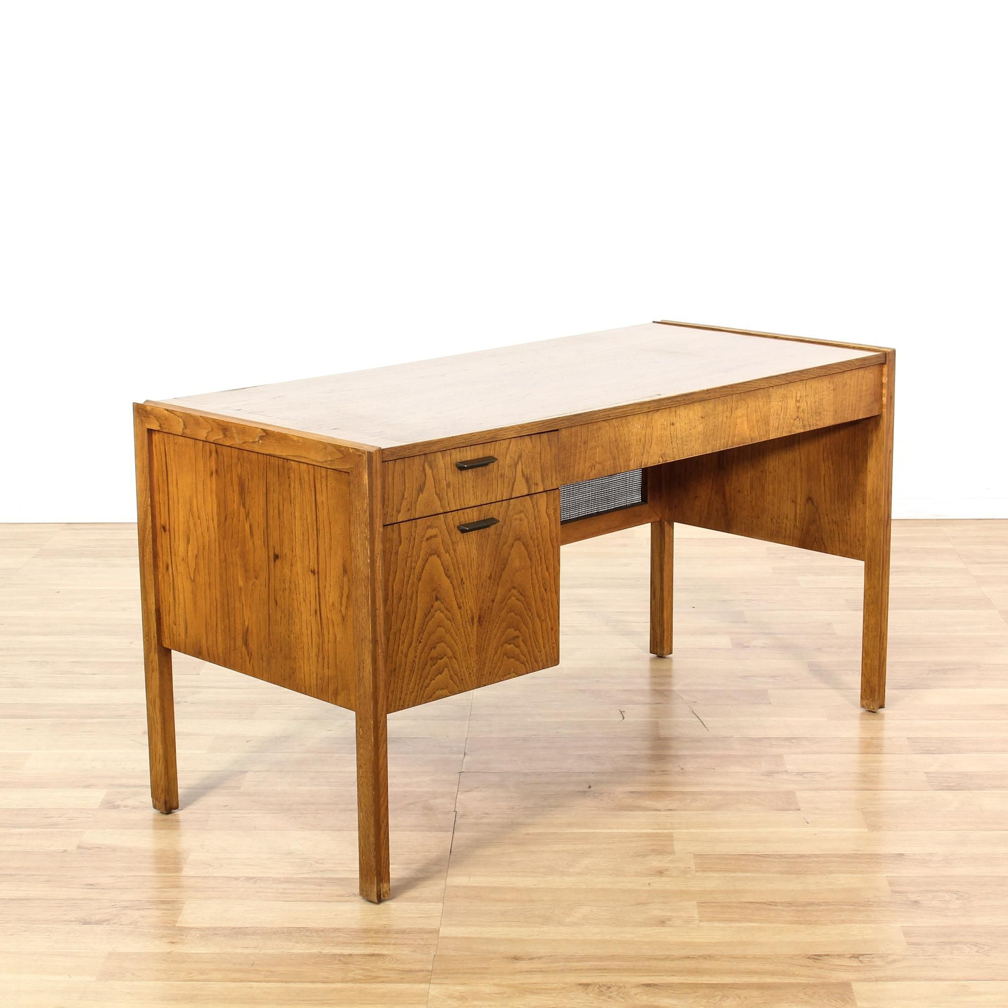 """This """"Founders"""" desk is featured in a solid wood with a gorgeous cherry finish. This mid century modern desk has 3 drawers in varying sizes, a woven back panel and simple straight legs. Sleek and stylish piece perfect for a home office! #americantraditional #desks #kneeholedesk #sandiegovintage #vintagefurniture"""