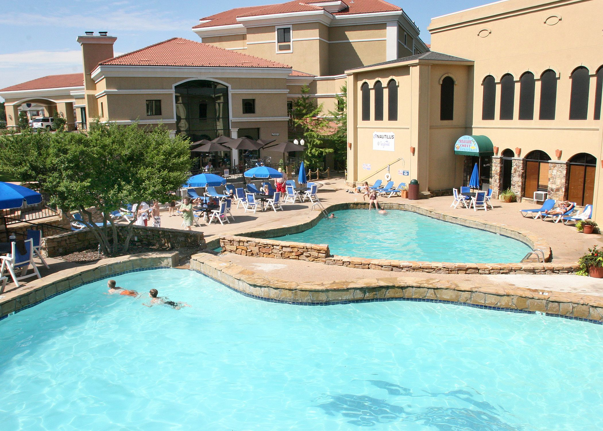 The outdoor pool at Tanglewood Resort and Conference Center (Pottsboro, TX)  - ResortsandLodges