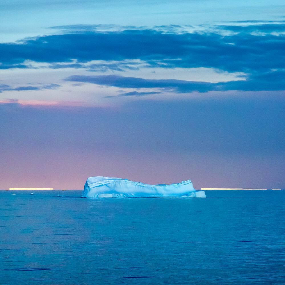 Photograph by @susanseubert // Icebergs lit by the midnight sun in the Gerlach Strait just off of the Antarctic Peninsula Photographed #onassignment for @natgeotravel #natgeoexpeditions #iceberg Follow @susanseubert for more! by natgeotravel