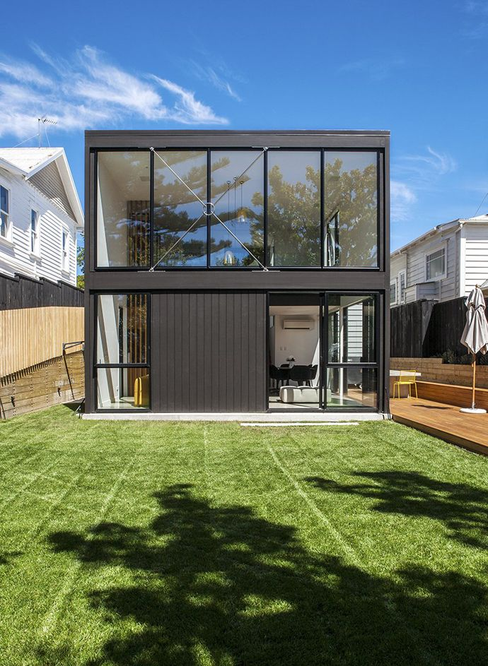 Two storey box shaped black facade with gloss black trim allows the home to blend traditional look fascinating modern box house for renewable traditional