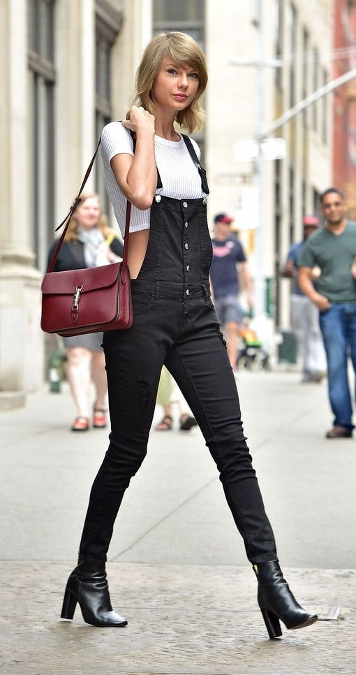Taylor Swift swapped her signature leg-baring styles for a pair of black overalls.