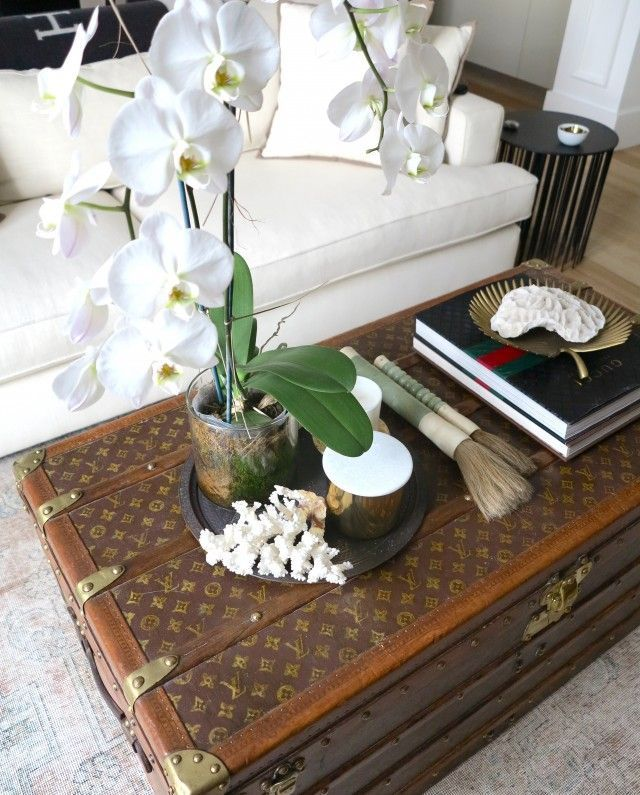 Fashionable Home Accents The Louis Vuitton Trunk The Decorista Pepino Home Decor Design Louis Vuitton Trunk Coffee Table Trunk Chic Coffee Table