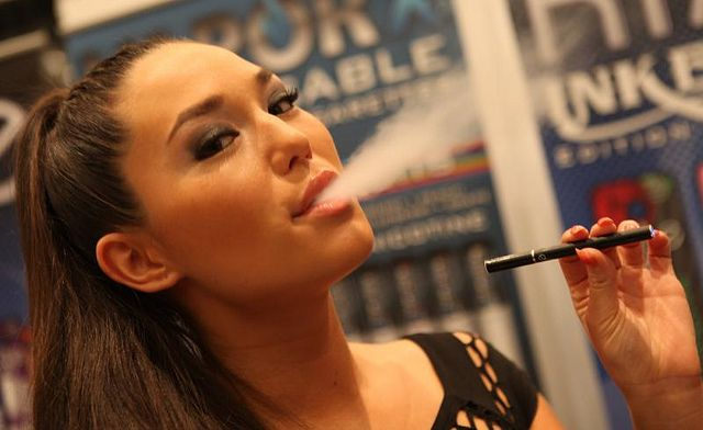 A female model demonstrating use of an electronic cigarette. Wikipedia: An electronic  cigarette,