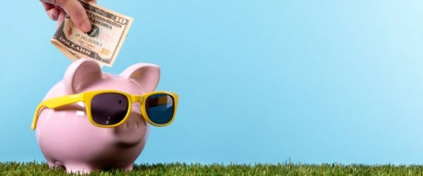 Piggy Bank savings - 5 ways to pay less for summer travel