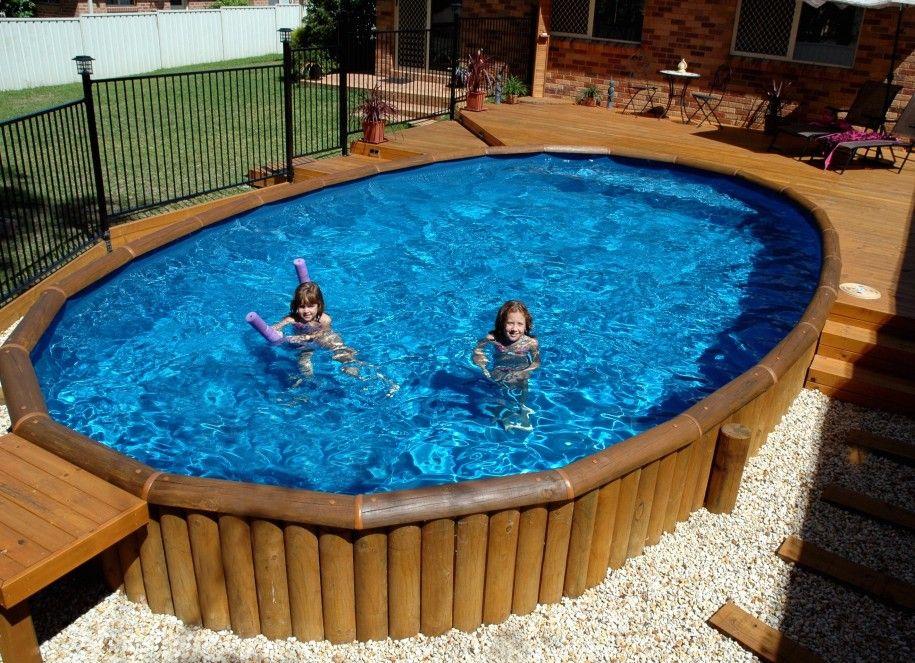 Unique Semi Inground Pools And Their Installation: Dark Metallic Fence  Wooden Deck Round Semi Inground