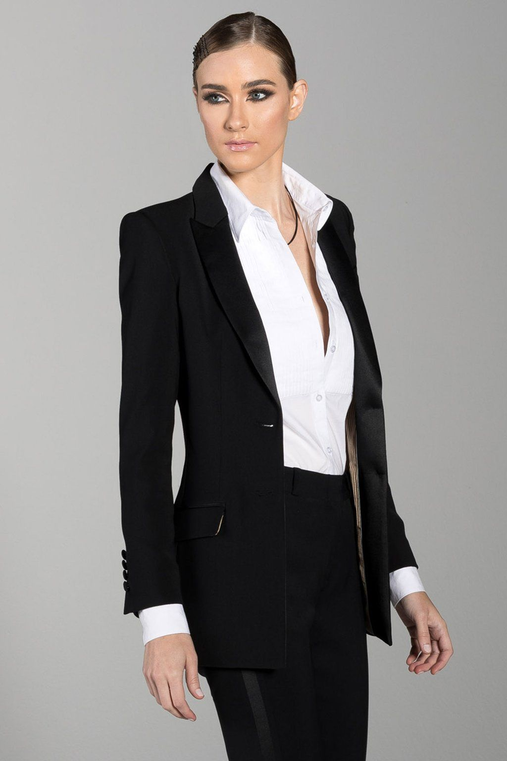 3244e7af991 Find your style with the women s Long Black Peak Lapel Tux Jacket. This  black woven tuxedo jacket features a longer length that makes it the  perfect fit for ...