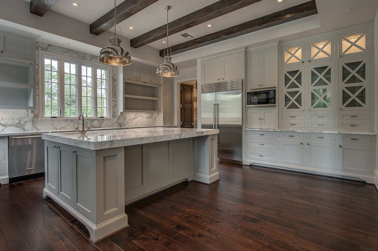 White And Gray Kitchen Features A Tray Ceiling Lined With