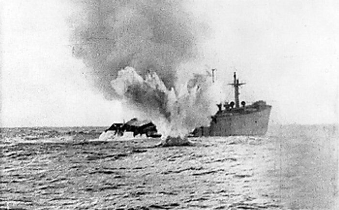 An Allied merchant ship being shelled by a German submarine, date unknown