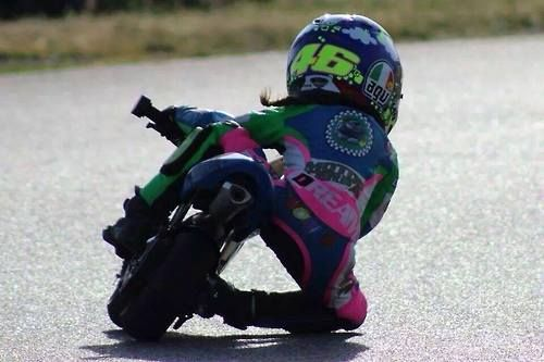 ...little girl sporting a Rossi helmet, full leathers, getting her knee down!